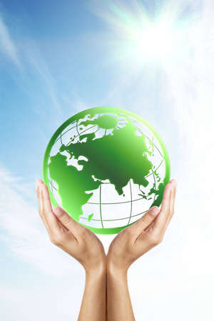 Hands holding a green Earth photo
