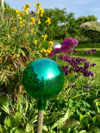 yard stick: Green glass ball on a stick in the garden