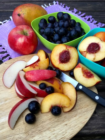 Fresh fruits with apples, nectarines and grapes on a darktable Stock Photo