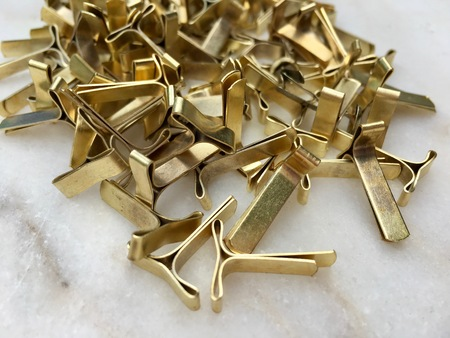 High angle view of locking clips for envelopes in closeup