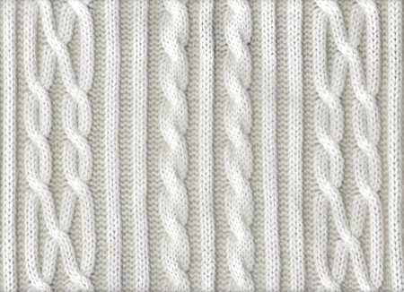 Knitted white texture with a pattern