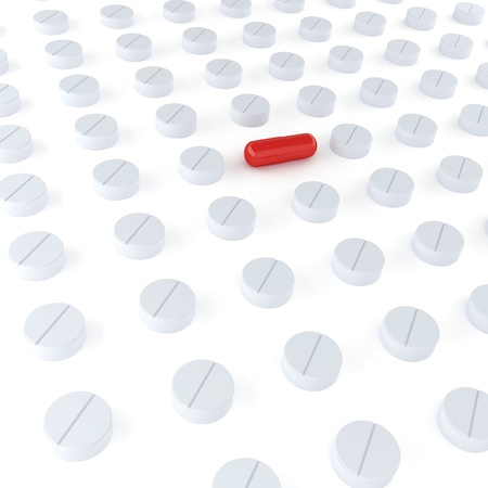 Tablets and red pill on the white background