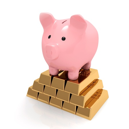 Piggy bank is standing on gold ingots Stock Photo