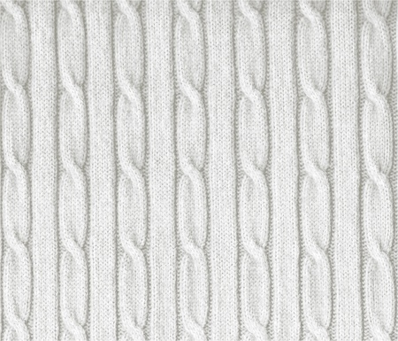 Knitted white texture with a pattern  photo