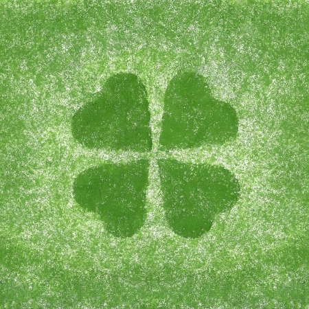 Clover with four leaves in grunge style in the paper