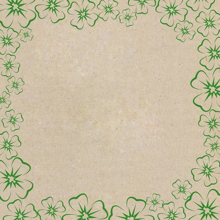 Frame of clover leaf on cardboard