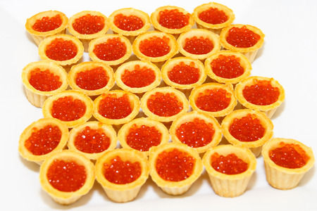 salty: Tartlets with salmon caviar,  fish a delicacy, caviar red fish, salmon ROE. Expensive dish with food. Seafood. The luxurious table. The background and texture. Salty caviar.
