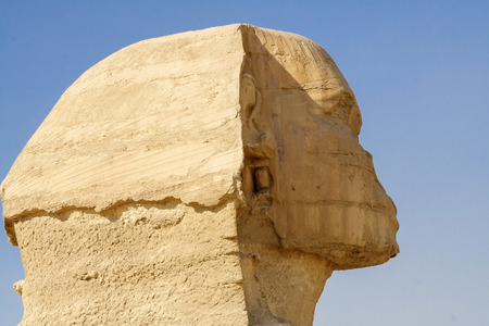 ancient civilization: Head of the Sphinx in the historical places. The ruins of antiquity, travel and tourism. Archaeological excavations. The ancient civilization of the pharaohs. Stock Photo