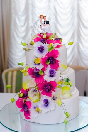 culinary arts: Wedding cake. The culinary arts sweets. Dessert food. The wedding decoration. Wedding table decorations for Banquet. Festive decorations. Freshness, idyllic and inspiration.