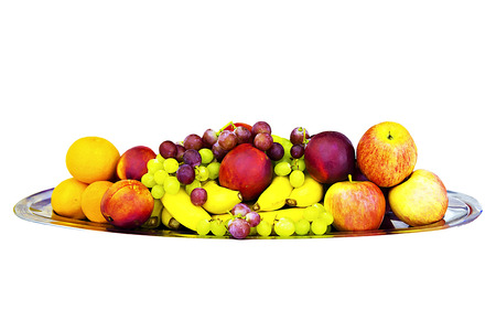 Mix of fruits on the platter. Fruits isolated on a white background. Apples and bananas, grapes, oranges, peaches. Dessert.