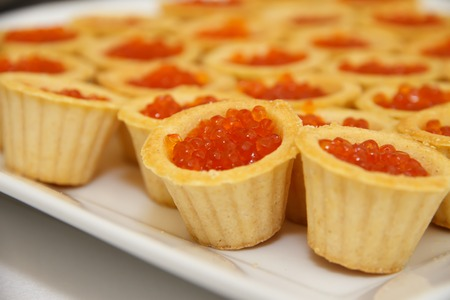 Tartlets With Salmon Caviar On Table Decorations Of Fish A Delicacy Caviar,  Red Fish Salmon