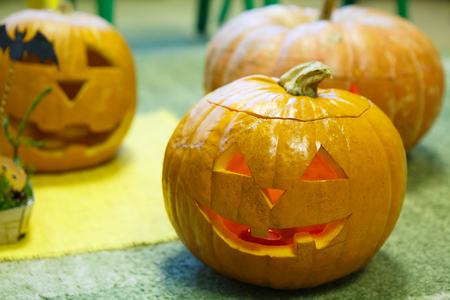 Head Pumpkin for Halloween. Holiday is celebrated October, eve of all saints Day. Trappings of Halloween in a pumpkin head with a candle inside. Main symbol of the holiday is the Jack-o-lantern.