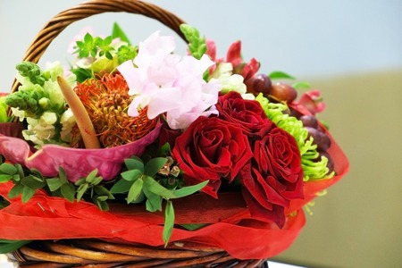 Wicker basket with flowers close.