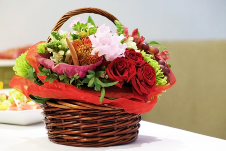Wicker basket with flowers. Stock Photo