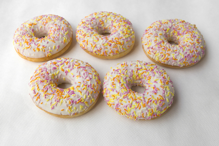 promotes: The dessert of donuts for Breakfast. Tasty food cakes. Delicious classic cakes: fried doughnuts glazed with caramel. Nutritious dish that promotes obesity.