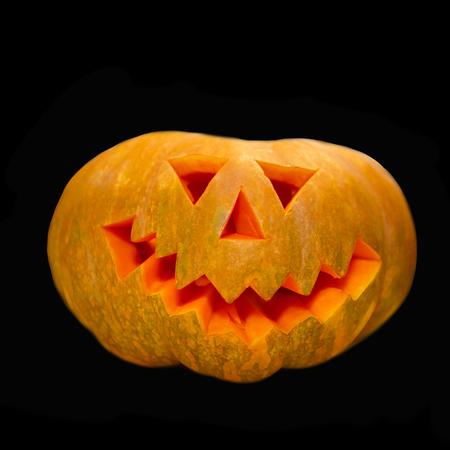 Festive symbol of Halloween. Cheerful smiling head of a pumpkin.