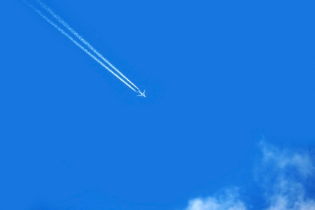 Army plane in the blue sky at high speed.