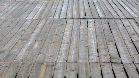 Background wooden plates gray. Natural flooring for items from planed boards. Rural design woode.