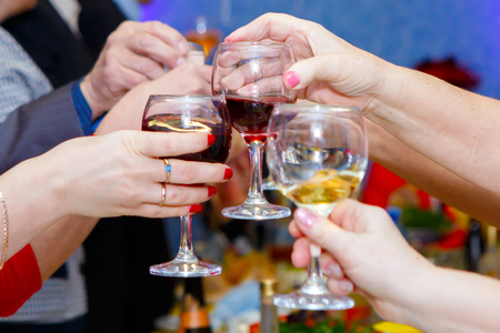 Pleasant company of drunks. Celebration drink at the Banquet. Alcohol in the hands of the celebrating people. Stock Photo - 123903180