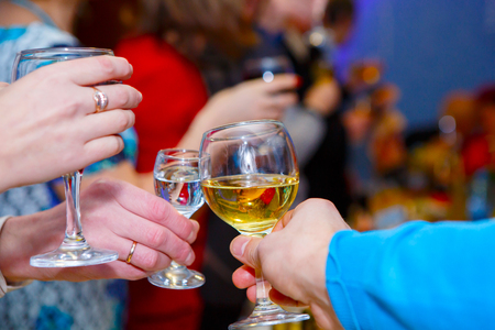 Pleasant company of drunks. Celebration drink at the Banquet. Alcohol in the hands of the celebrating people. Stock Photo - 123903183
