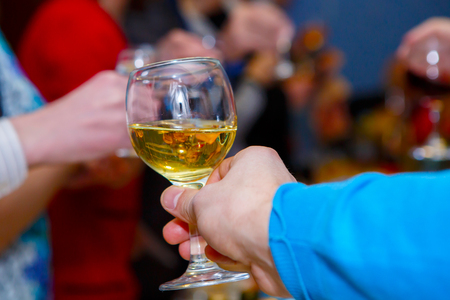 Pleasant company of drunks. Celebration drink at the Banquet. Alcohol in the hands of the celebrating people. Stock Photo - 123903184