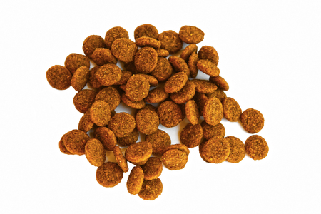 Nutrition food of dogs and cats on an isolated background. Food for the animals. Brown uniform pieces of dry food.