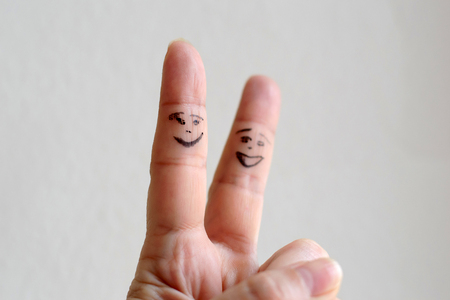 Funny abstract scene of the hand. A comic figure on the human body.