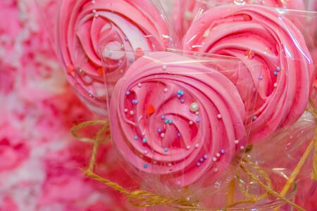 Shaped pink colored lollipops. Imagens