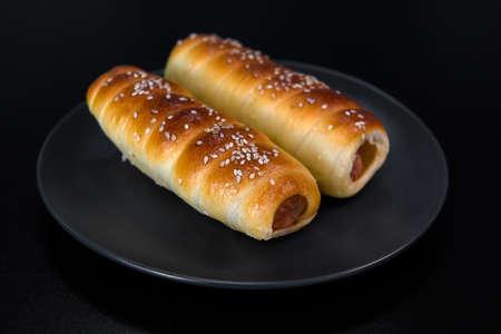 Sausage in the dough baked. Reklamní fotografie