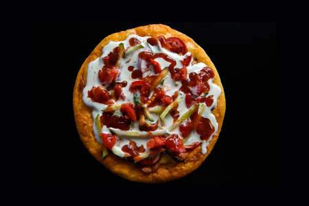 Pizza isolated on a black background.