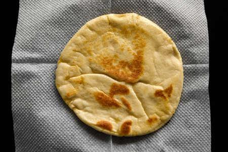 Baking flour tortilla on a platter. Reklamní fotografie