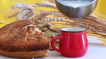 Freshly baked homemade bread and milk.