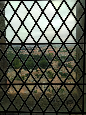 view from leaded or stained glass window in a cloudy day
