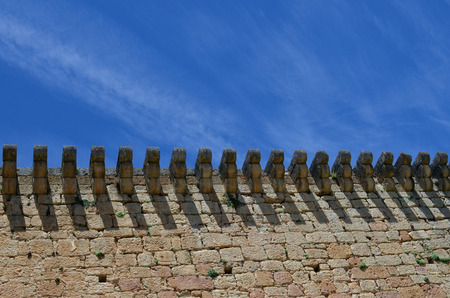 castle stone wall with blue sky Stock Photo