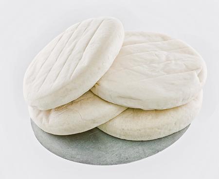 pizza base: flour Raw pizza base isolated on white background Stock Photo