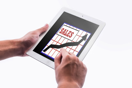 sales chart: businessman pointing the sales chart on pad isolated on white background
