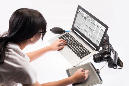 student working on a laptop computer- isolated over a white background
