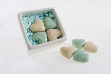 reciprocity: Beautiful  box and soaps as hearts on a white background