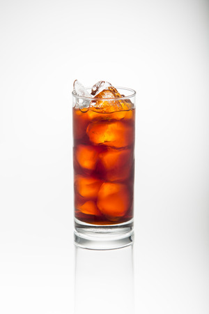 Glass of ice tea isolated on white