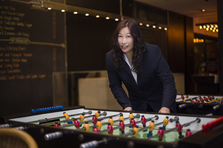 foosball: business woman playing foosball