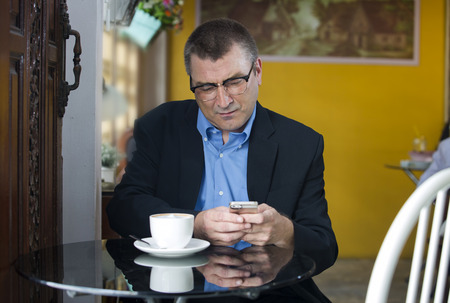perturbed: Worried businessman when he checking a mobile message in a cafe