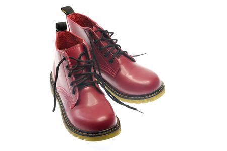 steel toe boots: The red leather boots isolated on white background