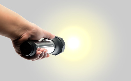hand holding torch flashlight