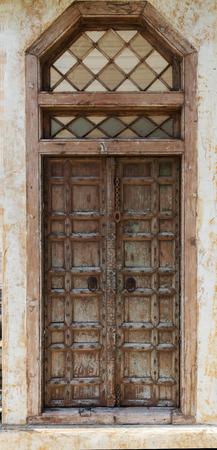 empty keyhole: Antique wooden entrance door