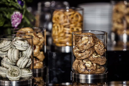 medium group of object: set of varieties of cookies on buffet table