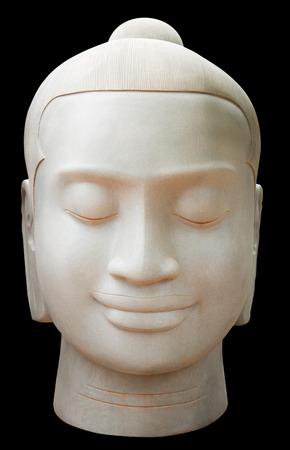 buddah: Buddah statue face against dark background.