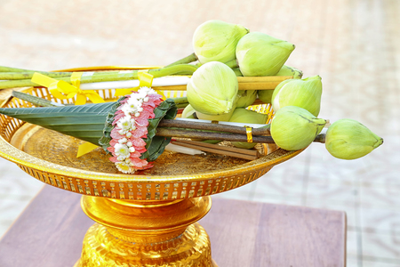 Flowers, incense and candles set for Buddhist worship Buddha