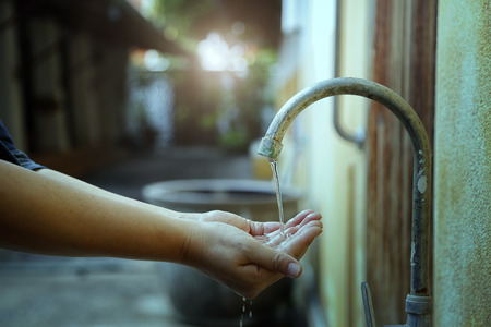Handwashing from faucets in countryside,Water flow less