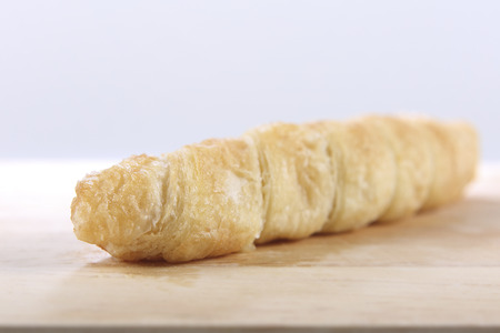 Cream Filled Cone Pastry on a wooden tray