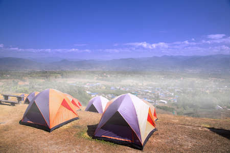 Camping tent on the hill of tourists in the morning